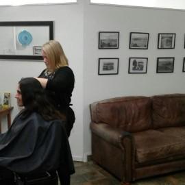 hairdresser cutting girls hair