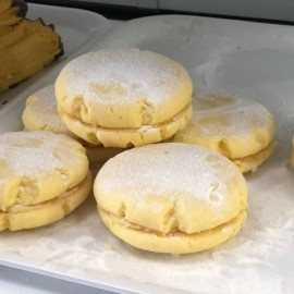 Biscuits on tray in cabinet
