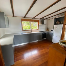 Grey & white kitchen with wooden floors