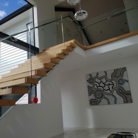Glass stair balustrade on timber stair
