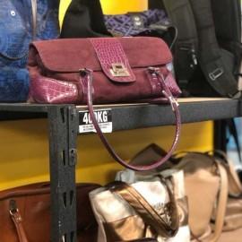 Maroon bag on shelf