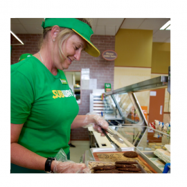 Woman in green shirt with cookies