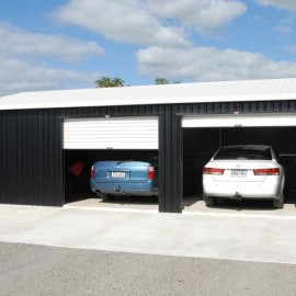 Blue car and white car in garage