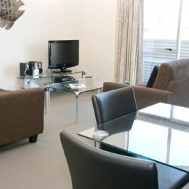 Glass table with chairs, lounge chairs and TV