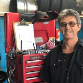 Man standing in front of toolbox