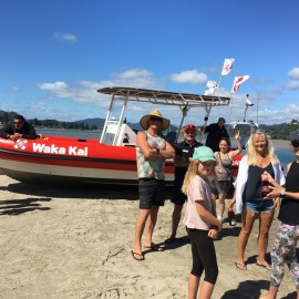 Waka Kai boat parked on beach