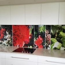 White kitchen with red flower splash back