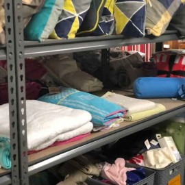 Sheets and towels on shelf