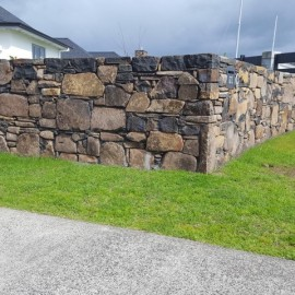 Rock wall and grass
