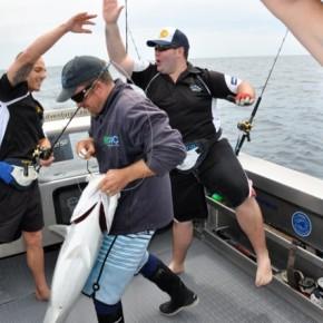 Men celebrating fishing