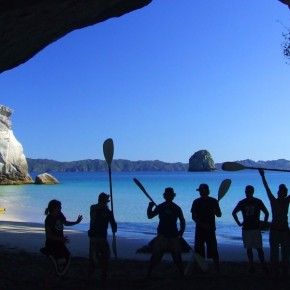 People holding paddles in cave