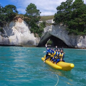 people on banana boat at cathedral cove nz