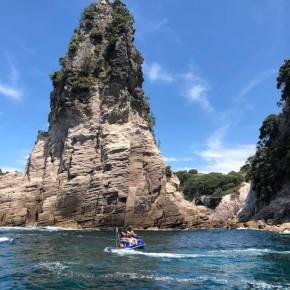 Jet ski in front of large rock