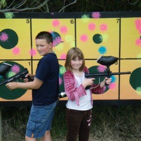 boy and girl with paintball guns