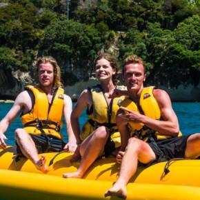 three people on yellow banana boat