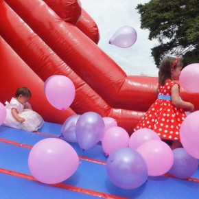 Pink balloons on bouncy castle