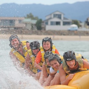 People in lifejackets on yellow banana boat