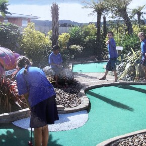 Kids playing mini golf