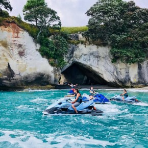people on jet skis at Cathedral Cove