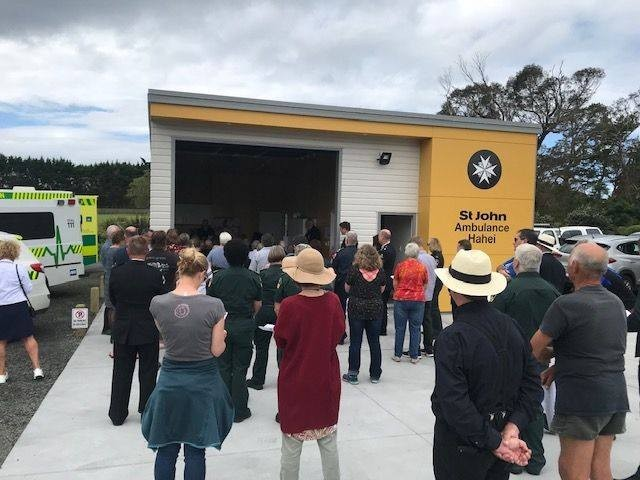 People standing at meeting outside the St  John Ambulance hall Hahei