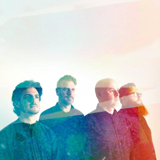 Four men in line