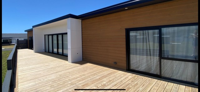 deck with house and sliding doors
