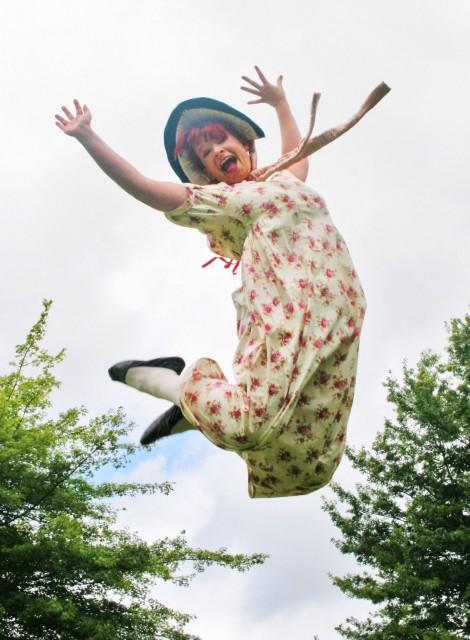 Woman in bonnet jumping - Austen Found