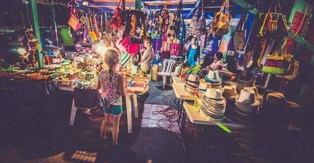 Girl at market stall