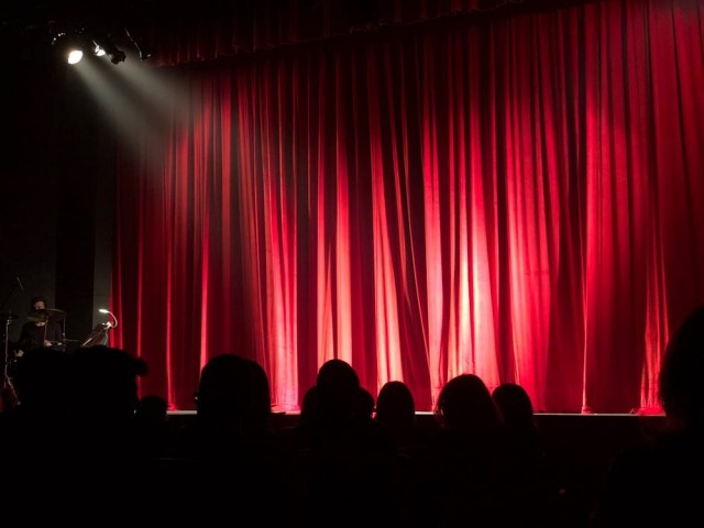 Red stage curtain with lights