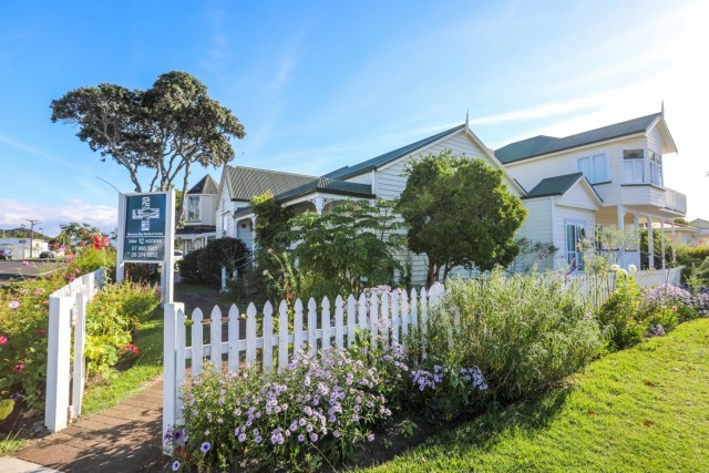 White picket fence and garden